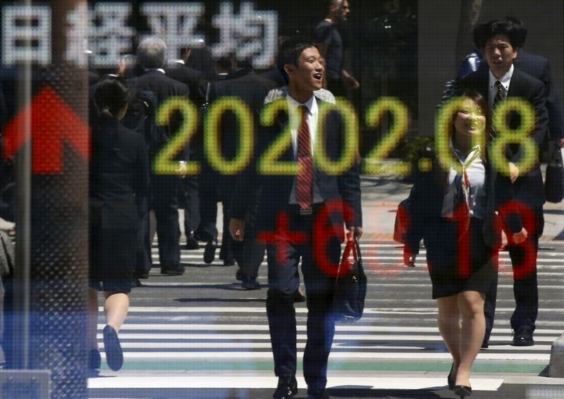 Asian shares pulled higher by China, eyes on Fed, U.S. GDP